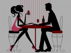 a single women and a single man are having wine during a speed dating event